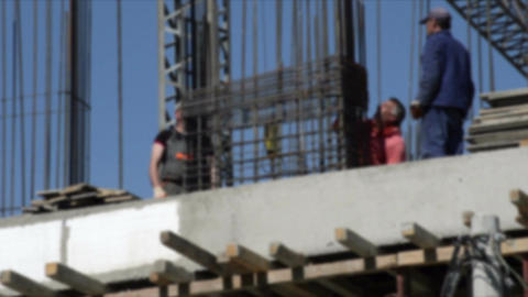 Building house and group of construction workers Footage