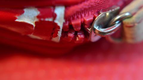 Close up of red broken bag zipper Footage