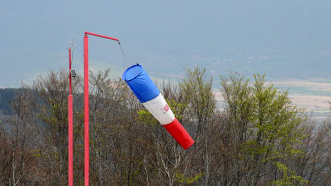 wind sock - red , blue and white pointer indicating strength and direction of th Footage