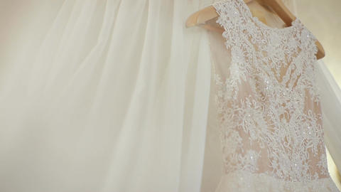 Beautiful white dress of the bride. Morning bride