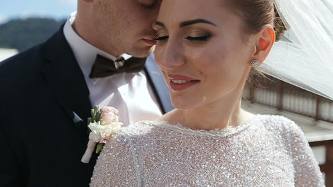 Beautiful wedding couple in mountains. Young beautiful couple bride and groom on Footage