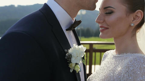 Beautiful Wedding couple kissing on the background of sunset Footage