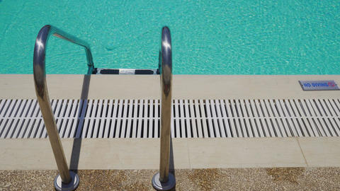 Outdoor swimming pool ladder with no diving sign on poolside ビデオ