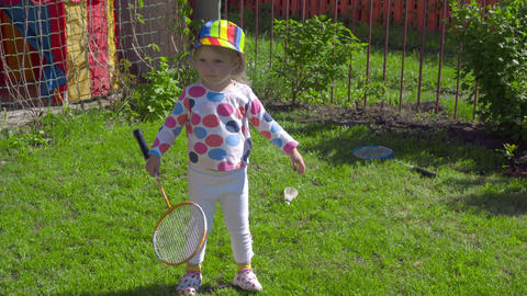 Girl with badminton rackets Footage