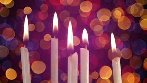 Burning candles and blurred lights on background loopable Footage
