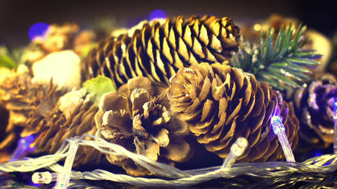 Pine cones and blinking christmas lights seamless loop Footage
