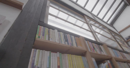 The books are lining up on the bookshelf Live Action