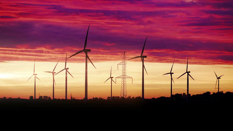 Video of windmills at the sunset in 4K Footage