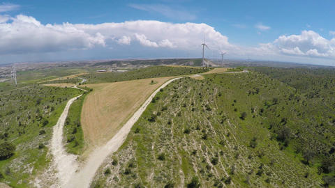 Large wind farm rising above Cyprus hills, production of alternative energy Footage