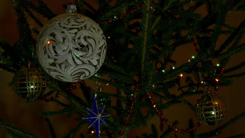 4K Branches of Decorated Christmas Tree in Evening Room Twinkle With Footage
