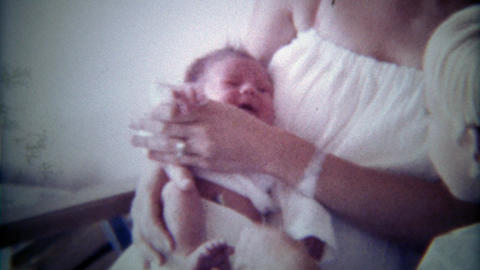 1978: Brother greets newborn sister baby for 1st time Footage