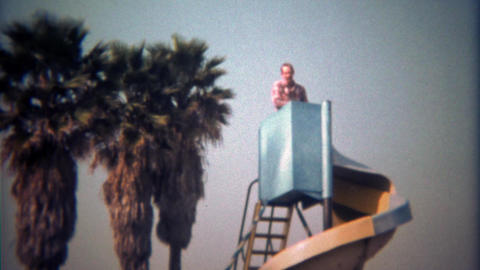 1979: Father goes solo down twisting playground public park slide Live Action