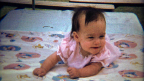 1971: Happy newborn baby curiously looks around suspicious of her environment Footage