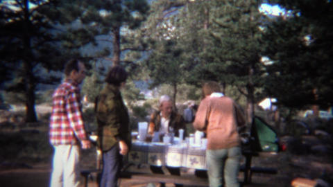 1971: Adult outdoor picnic table camping stove family meal Footage