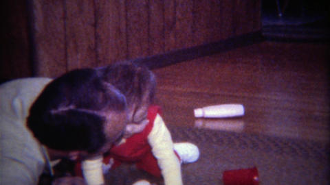 1971: Baby gives dad kiss during quality play time Footage