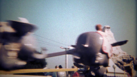 1979: Disneyland Dumbo amusement park ride with dad and son Footage