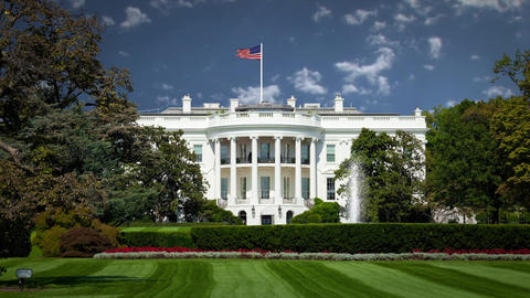 White house with Background Clouds in Timelapse USA Flag Waving Footage