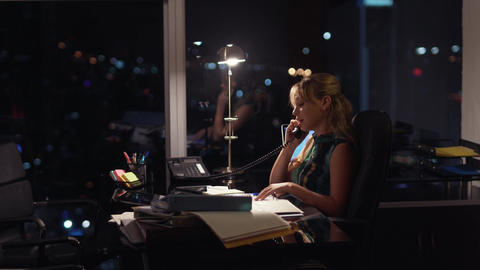 4 Businesswoman Working Late At Night Answering Phone Call Footage
