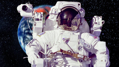 Astronaut on a Spacewalk with the Planet Earth in Background Live Action
