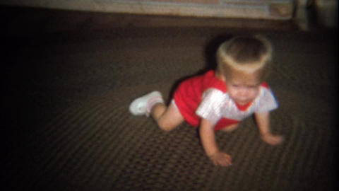 1974: Baby boy crawling head first on carpet rug Footage
