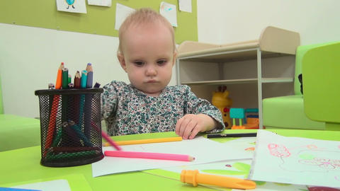 Little baby plays with pencils Footage