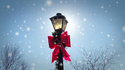 Christmas Lamp Post with Giant Red Bow During a Snowstorm Footage