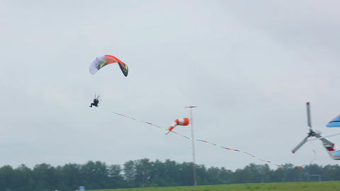 Moto paraglider on airshow Live Action