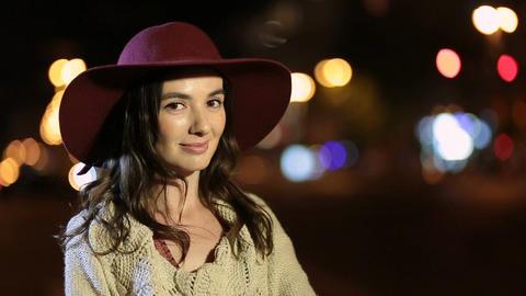 Elegant charming woman smiling in night city Filmmaterial