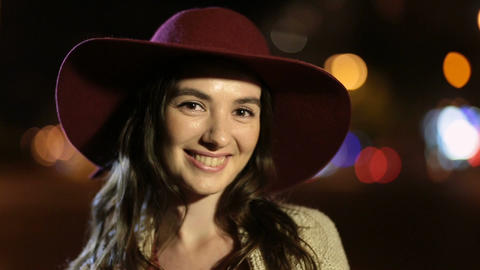 Beautiful woman with enigmatic smile at night Footage