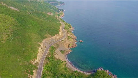 Aerial View Highway with Driving Car along Rocky Slopes Footage