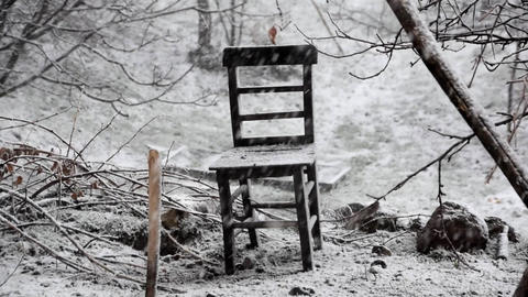 Heavy snow outdoor and alone old wooden chair