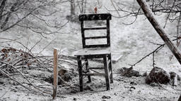 Heavy snow outdoor and alone old wooden chair 画像