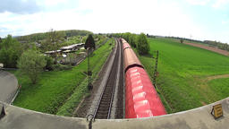 Cargo train passing under bridge Footage