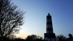 lighthouse with rotating spotlight during sunset Footage