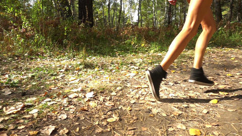 Young Girl Runs Along Forest Path Footage