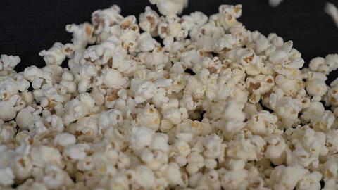 Frontal shot of Popcorn falling in slow motion