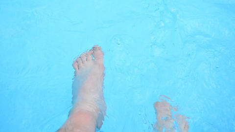 Refreshing feet in a pool