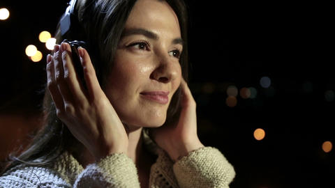 Romantic woman with earphones enjoying music Footage