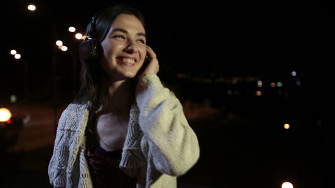 Calm brunette woman enjoying music in headphones Footage