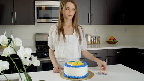 Attractive Woman Preparing A Birthday Cake Live Action