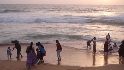 People play with the waves on beach,Kandy,Sri Lanka Footage