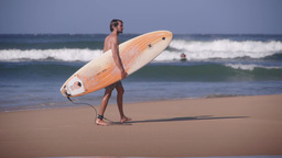 Surfer Tourist With Surfboard,Arugam Bay,Sri Lanka stock footage