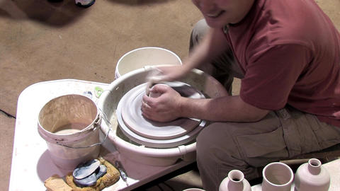 Molding Clay on a Pottery Wheel Footage