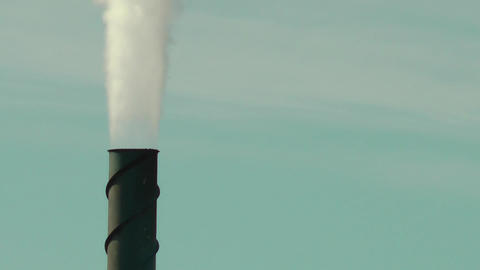 Smoke Stack Against a Slightly Clouded Background 3 Footage