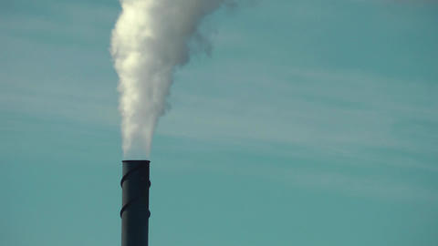 Smoke Stack Against a Slightly Clouded Background Footage