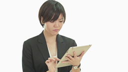 Asian businesswoman frustrated with tablet computer Live Action