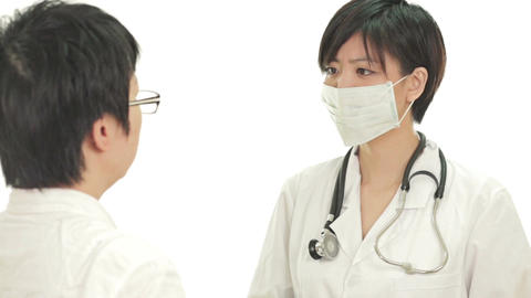 Asian Doctor Patient Discussion stock footage