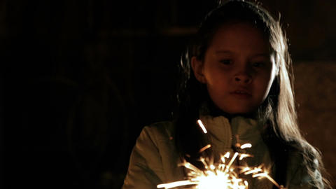 Young girl with sparkler scared to happy Footage