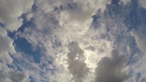 Large fluffy clouds hiding summer sun in the sky, beautiful cloudscape timelapse Footage