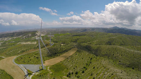 Large wind turbines standing in the fields, eco-friendly electricity generation Live Action